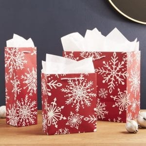 red and white with snowflakes paper bag