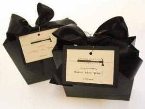 black gift bag with black bow