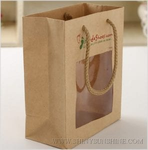 windowed brown bag with material handles
