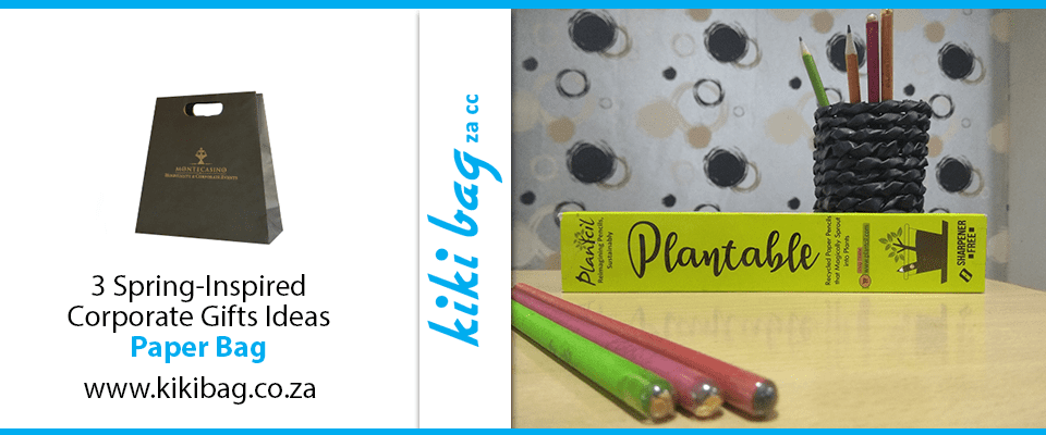 3 plantable pencils next to their box on a countertop in front of a polka dot backdrop